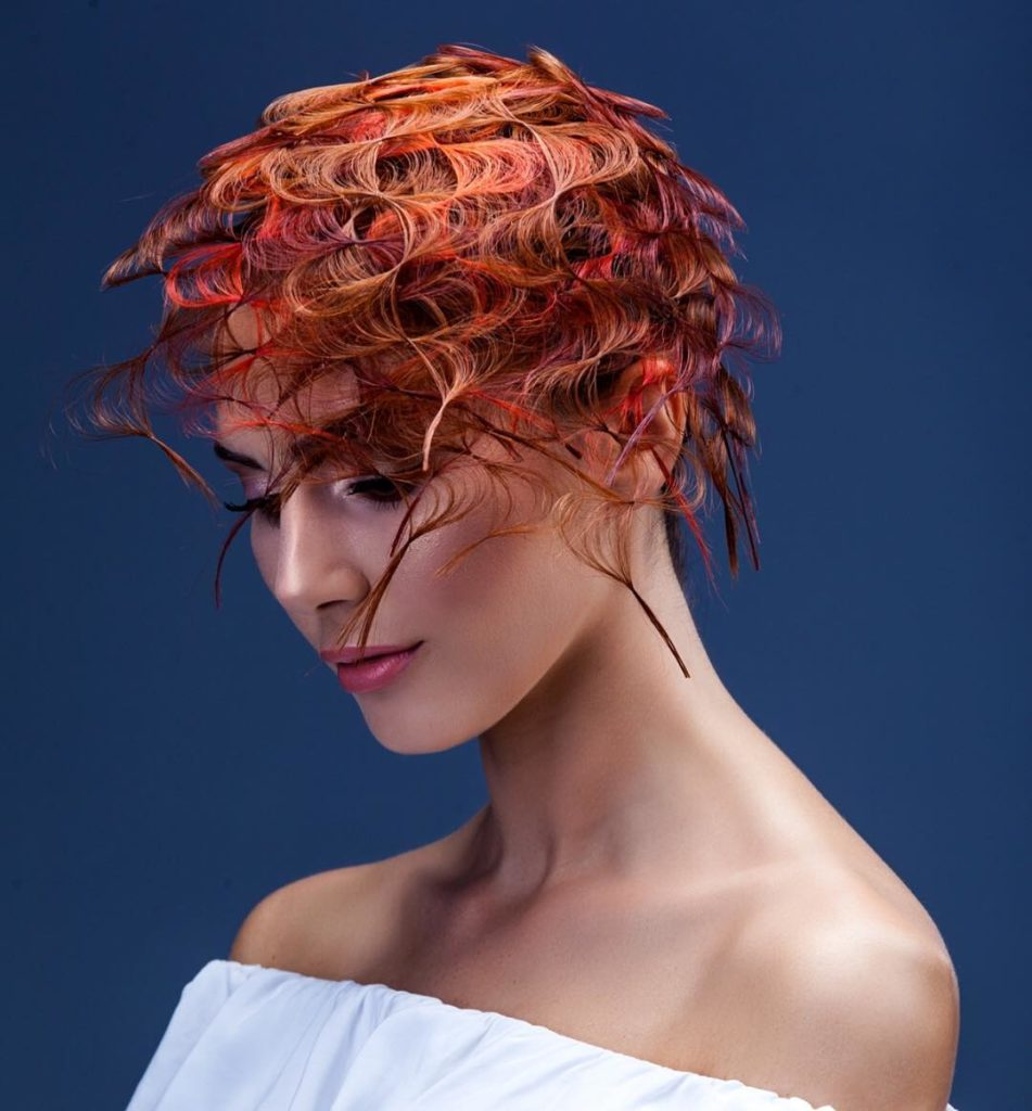 messy curly red hairstyle