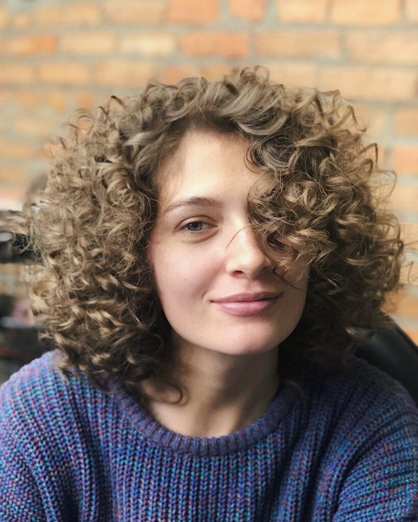 curly wavy medium lenght hairstyle