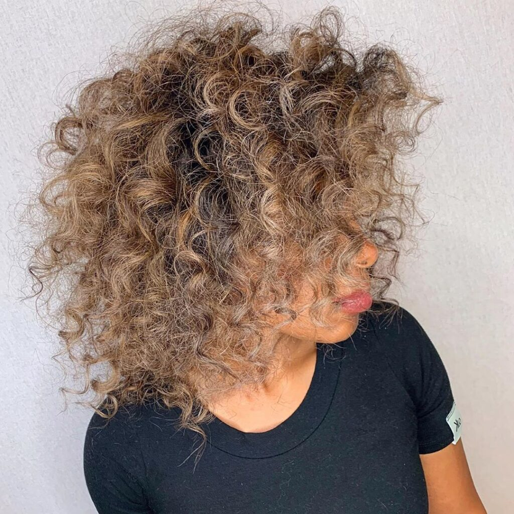 curly light brown hairstyle