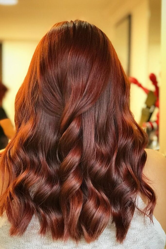long wavy braid red hairstyle