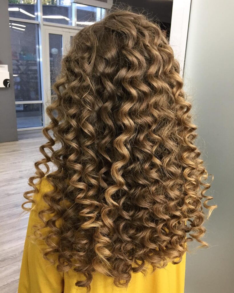 curly choppy blonde hairstyle