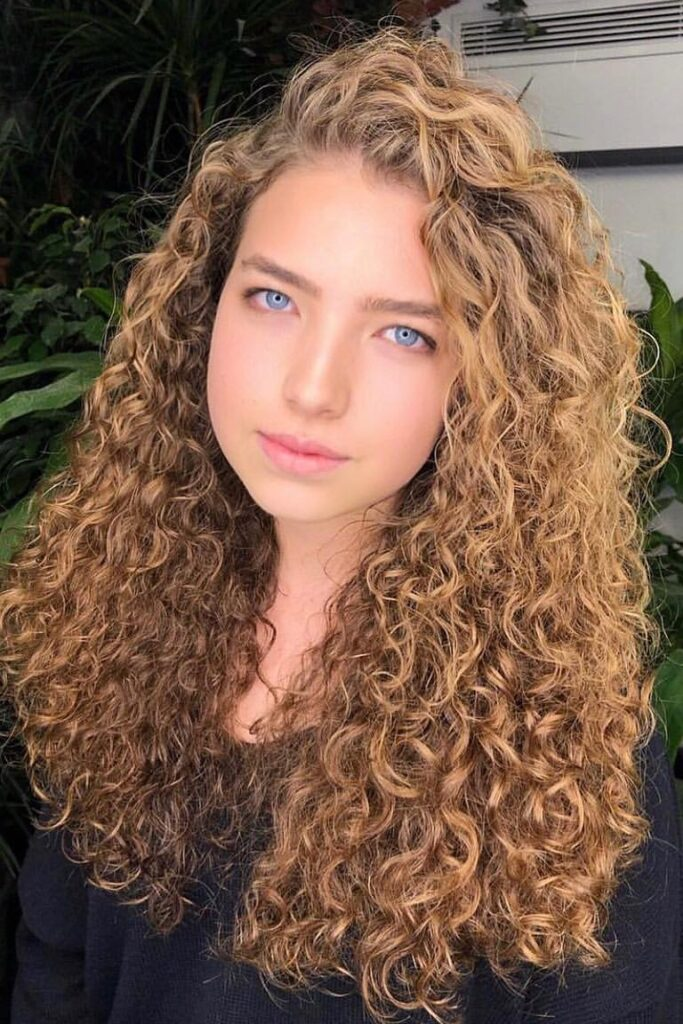 curly thin blonde hairstyle