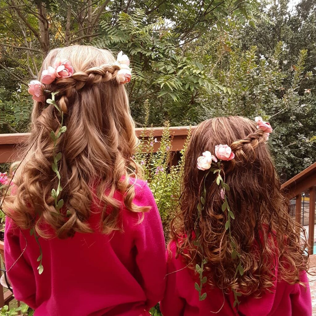 flowers in the hair of girls with wavy hair