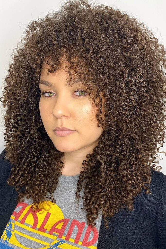 curly thin brown hairstyle