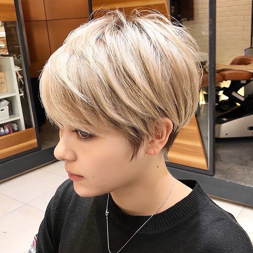Short pixie blonde hair on the sides